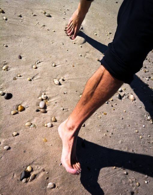 Barefoot running in the sand on a beach in Long Island