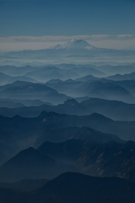Flying into a sunny Seattle, the lifting fog shows Mt. Rainier.